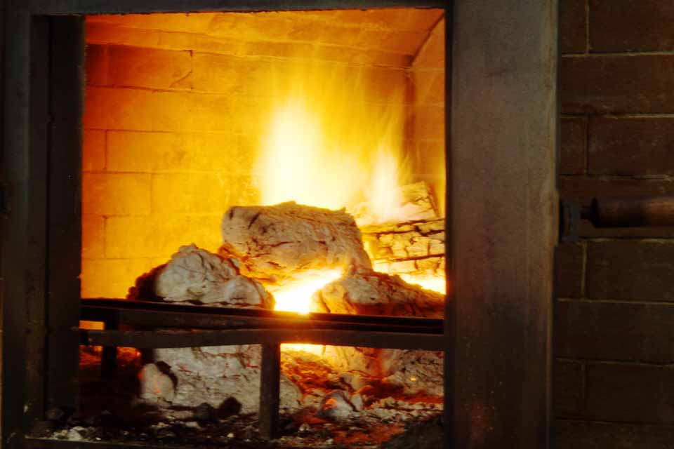 Our best kept secret, our custom-built wood-fired oven